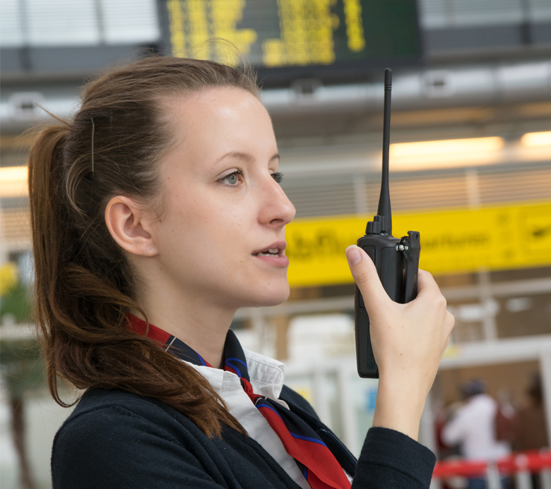 Airport Woman Outside an airplane with KENWOOD headset and hand mobile radio